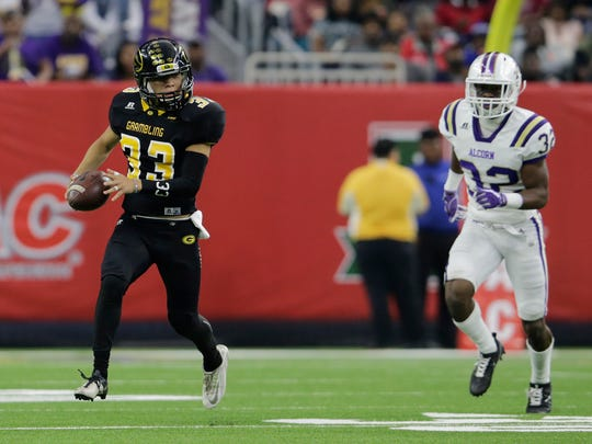 Grambling State punter Miguel Mendez (33) rushes on a fake punt while pursued by Alcorn State defensive back Qwynnterrio Cole (32) in the first quarter during the Southwestern Athletic Conference championship football game in Houston, Texas, Saturday, Dec. 2, 2017. (Tim Warner/Houston Chronicle via AP)