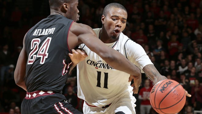 Cincinnati Bearcats forward Gary Clark (11) drives to the hoop against Temple Owls center Ernest Aflakpui (24) in the second half.