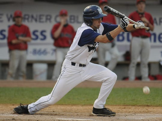 Bay Port's Zac Peterson (12) lays down a bunt to score the game-winning run in extra innings during the WIAA Division 1 state championship game against Wilmot Union at Fox Cities Stadium in Grand Chute in 2009. It was the first team state title in school history.