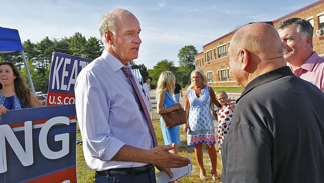 Congressman Bill Keating talks with voters outside Marshfields  polls at the Furnace Brook Middle School on Tuesday, Sept.4, 2018. Greg Derr/ The Patriot Ledger