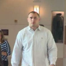 Colt Lyerla (right) and his attorney, Stephen Houze (left), arrive for a court hearing on September 17.
