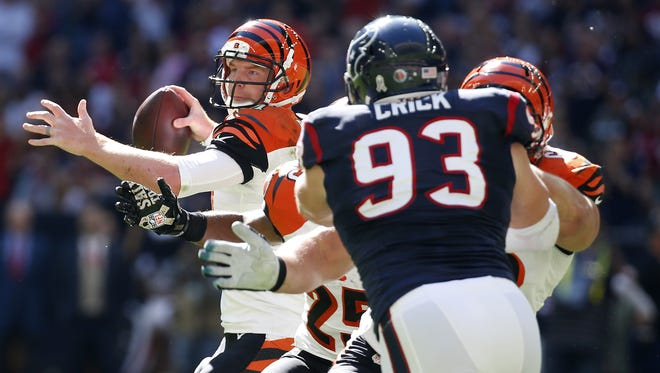 Bengals quarterback Andy Dalton (14) looks to pass in the second quarter against the Houston Texans at NRG Stadium.