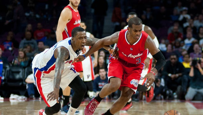 Clippers guard Chris Paul (3) fouls Detroit Pistons guard Kentavious Caldwell-Pope (5) while battling for lose ball during the fourth quarter at The Palace of Auburn Hills. Los Angeles won 104-98.