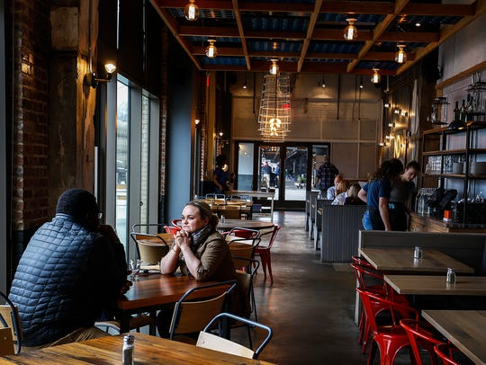 Patrons enjoy lunch at Next Door American Eatery located