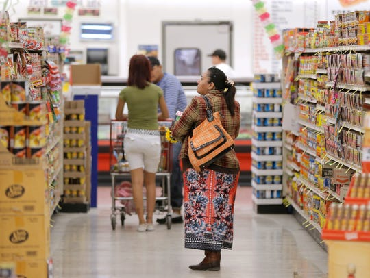 Silva's Supermarket customers browse the aisles Monday.