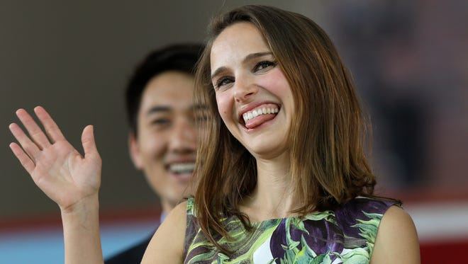 Actress Natalie Portman waves as she takes the stage at Harvard College's Class Day, Wednesday, May 27, 2015, on the campus of Harvard University, in Cambridge, Mass.