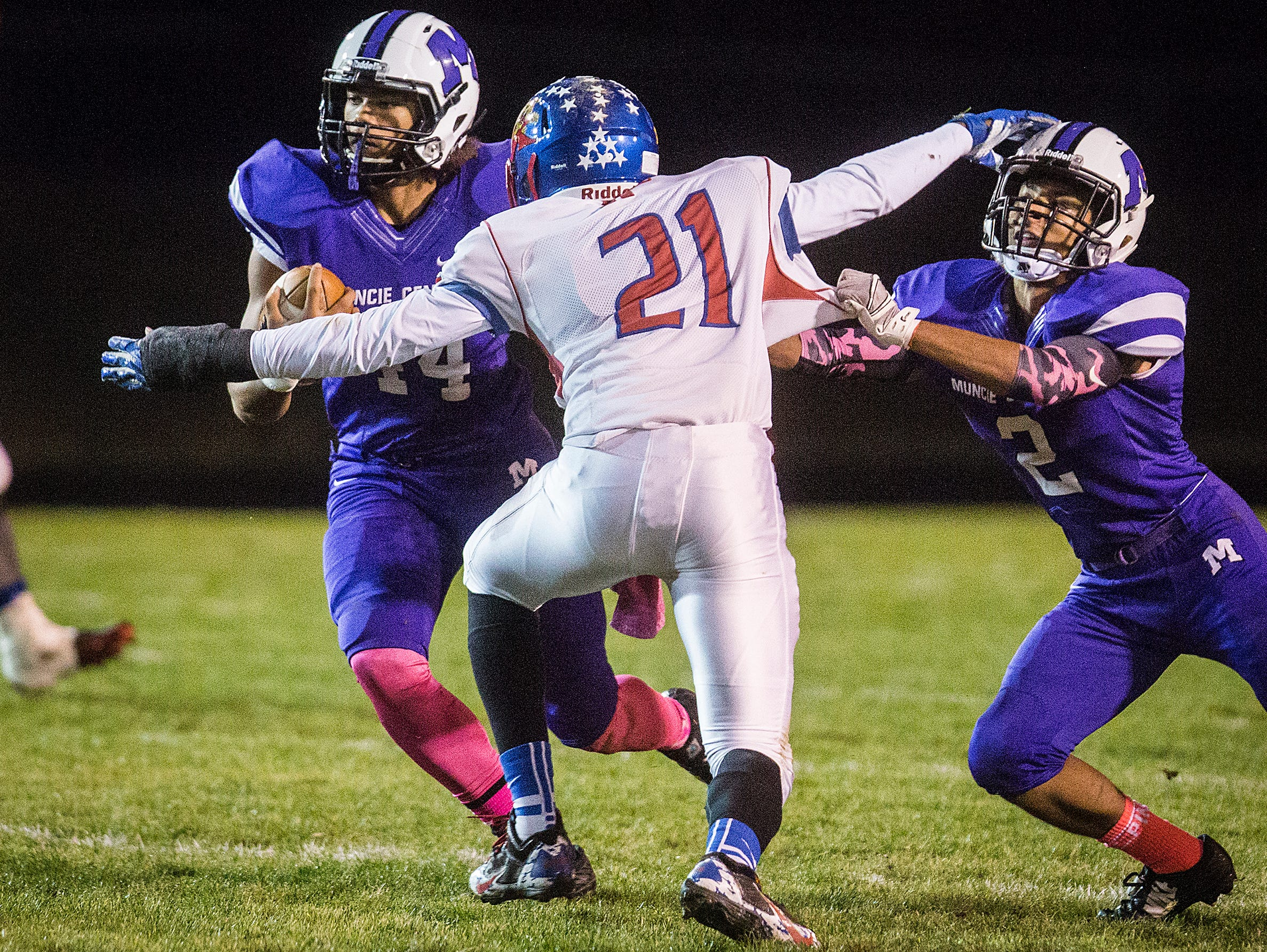 Central's Andre Wells struggles past Kokomo's defense during their game at Central Friday, Oct. 30, 2015.