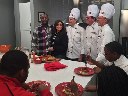 TV Personality Rachael Ray shows off a renovated kitchen at Downtown Boxing Gym on Detroit's East Side on Monday, Nov. 16. Ray stands with the gym's founder Khali Sweeney and chefs from the Art Institute of Michigan, who will return to the gym for healthy cooking lessons.