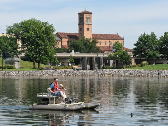 Brian and AJ Crabtree guide their paddleboat on Lake George during Saturday's Celebration of Fatherhood event.