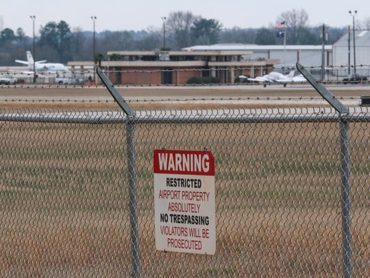 No trespassing signs warn those outside the Anderson Regional Airport fence near S.C. 24 in Anderson.