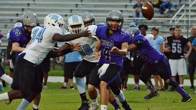 Space Coast quarterback Bradley Cantrell shovels the ball off Monday night in their home game against the Rockledge Raiders.