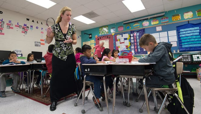 First-grade teacher Nicole Anderson works with her students at North Georgetown Elementary School in Georgetown. Findings of an audit by the state of the Indian River School District show inconsistencies in the way taxpayer funds were handled.