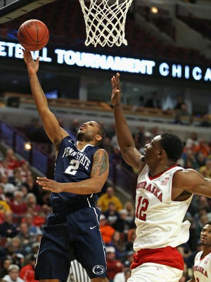 CHICAGO, IL - MARCH 11: D.J. Newbill #2 of the Penn State Nittany Lions puts up a shot past Moses Abraham #12 of the Nebraska Cornhuskers during the first round of the 2015 Big Ten Basketball Tournament at the United Center on March 11, 2015 in Chicago, Illinois. Penn State defeated Nebraska 68-65. (Photo by Jonathan Daniel/Getty Images)