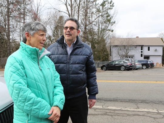 Hilda Kogut and Bruce Goldsmith, neighbors with Citizens United to Protect Our Neighborhood, stand across the street from the former Edwin Gould property in Chestnut Ridge, Jan. 19, 2017. They are concerned about the safety of the school children on the property, in allegedly uninspected buildings.