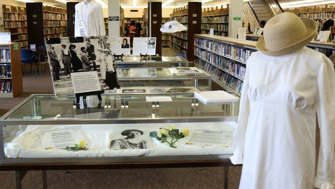 An exhibit featuring photos, letters, clothing and other memorabilia from the women's suffrage movement during the 1920s are seen on display during a reception honoring Sue Shelton White on Wednesday, May 16, 2018, at the Jackson-Madison County Library.