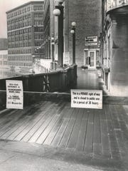 Owners of the riverwalk between E. Wisconsin Av. and E. Mason St. on the east side of the Milwaukee River reassert their ownership by closing it to public access in this March 19, 1958, Milwaukee Journal photo.