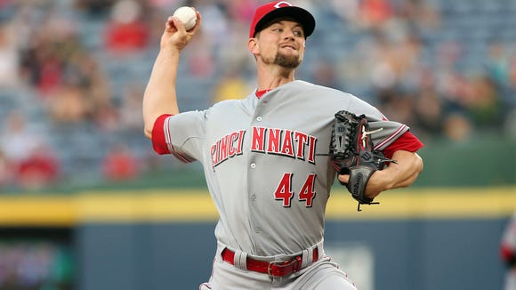 Reds starting pitcher Mike Leake delivers during the