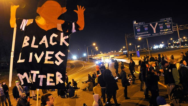 Demonstrators block Interstate 24 at Shelby Avenue on Tuesday night after marching through downtown protesting a grand jury's decision not to indict a white police officer in Ferguson, Mo.
