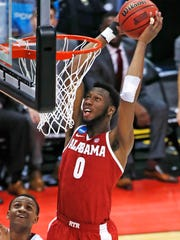 Alabama 's Donta Hall dunks in front of Virginia Tech's Nickeil Alexander-Walker during the second half of an NCAA men's college basketball tournament first-round game in Pittsburgh, Thursday, March 15, 2018. Alabama won 86-83. (AP Photo/Gene J. Puskar)