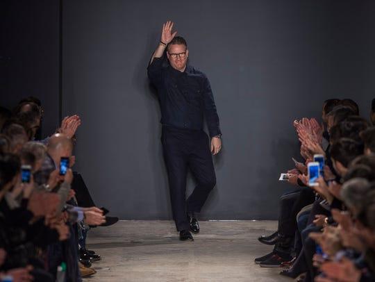 Designer Todd Snyder waves after the presentation of