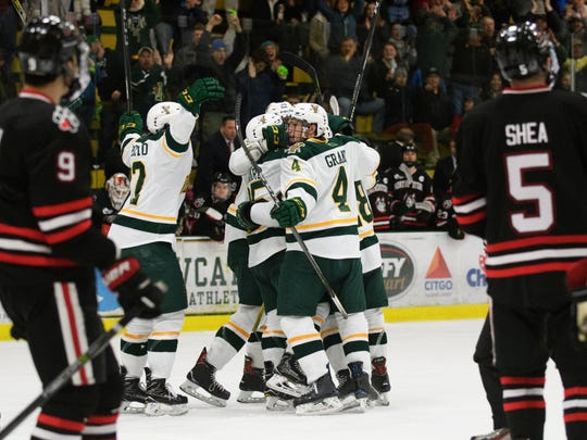 Vermont celebrates scoring a goal with just seconds left on the clock to send the game into overtimemduring the men's hockey game between the Northeastern Huskies and the Vermont Catamounts at Gutterson Fieldhouse on Friday night February 16, 2018 in Burlington.