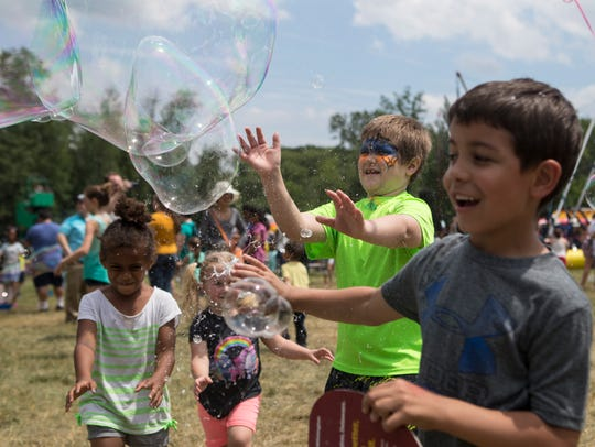 Festival goers enjoy games, entertainment, and ice