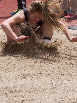 Centennial's Mariah Kinney, hits the sand in the Triple Jump event at the track meet held at Field of Dreams, Saturday, April 29, 2017.
