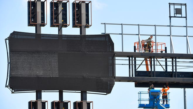 Technicians replace LED panels on the guitar scoreboard at the Sounds First Horizon Park in Nashville, Tenn. on May 7. The park could host a team of free agents this summer to support major league baseball rosters.