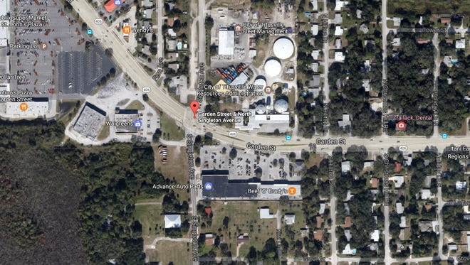 Treated waste was cleaned from the roadway following an accident at the intersection of Singleton Avenue and Garden Street in Titusville.