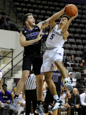 Abilene Christian's Payten Ricks (5) gets fouled by Central Arkansas' Tanner Schmit (22) during the second half of the Wildcats' 81-76 loss on Thursday, Jan. 5, 2017, at ACU's Moody Coliseum.