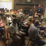 Cpl. Greg Freudenthal with the Hendersonville Police Department speaks to members of the Glen Oak neighborhood on Tuesday, July 26, 2016.