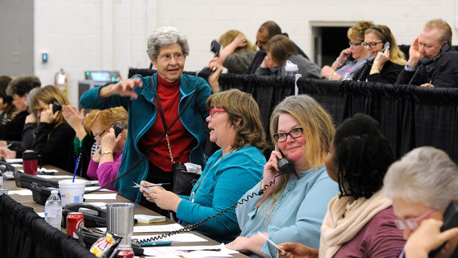 Volunteer Maxine Williams (center) stands up to announce a $100 donation she just received during the West Texas Rehabilitation Center's Rehab Phonathon, which began Wednesday, Jan. 18, 2017, at the Abilene Convention Center. The Rehab Telethon begins at 7 p.m. Saturday at the Abilene Convention Center, formerly the Abilene Civic Center. Tickets are $12.