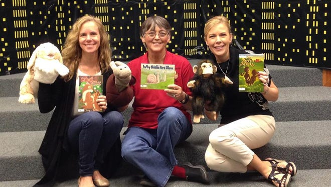 Terry Bethea, center, has been delivering copies of her three children's books to local school libraries. The books are being donated by people in the community.