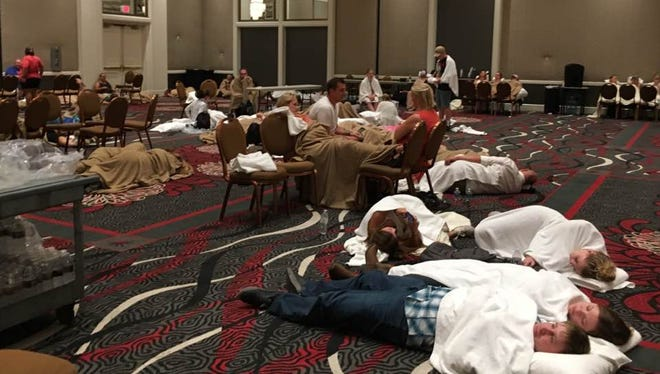 Tom and Nancy Gamm of Ross, Ohio, spend the night on a floor at the MGM Grand Hotel after a gunman opened fire at a country music festival in Las Vegas.