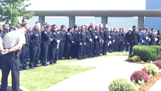 Lafayette Police officers gather after service for Cpl. Michael Middlebrook, killed Sunday in the line of duty.