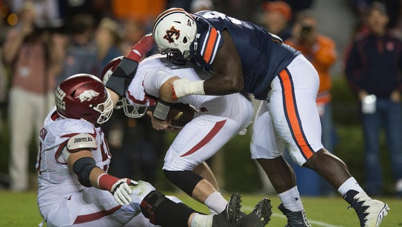 Auburn defensive lineman Devaroe Lawrence (94) tackles