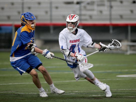 Fairport's Reese Burek (41) driving to the goal in a game against Irondequoit.