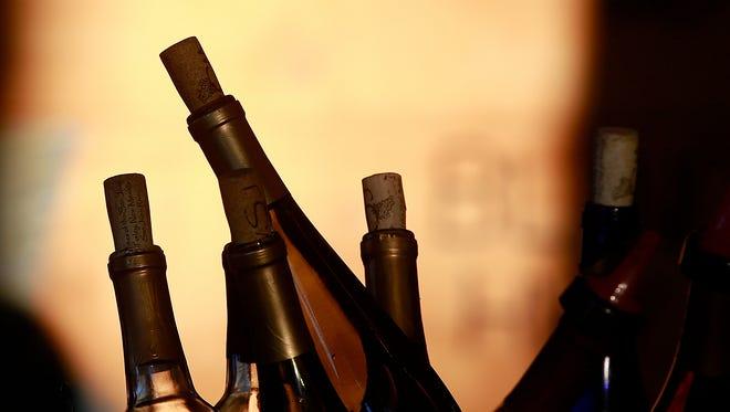 Bottles of wine chill in a bucket.