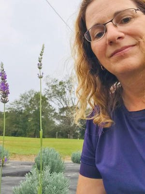 Elinor Poole with some of the lavender she and her husband grow at their farm in Barnwell County.