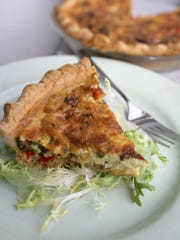 Ham, Leek and Mushroom Quiche is enlivened by chopped red pepper and Dijon mustard.