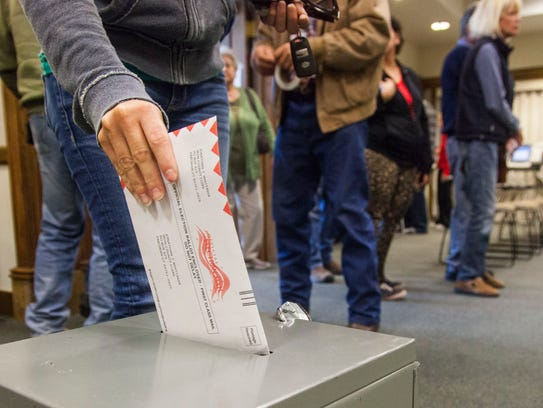 A Cedar City resident drops of their ballot at the