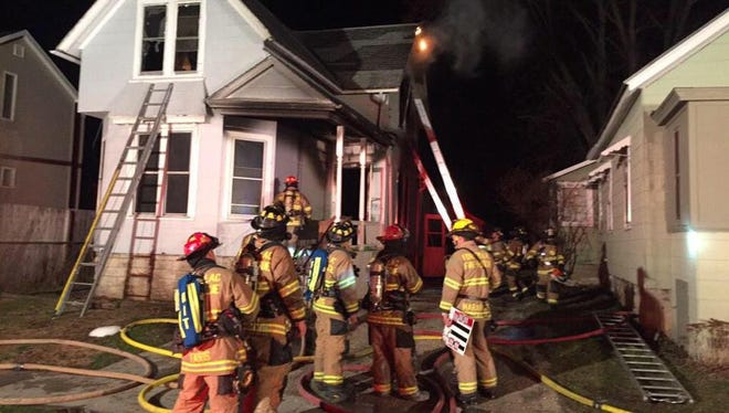Fire crews battle a house fire on Lincoln Street Monday morning.