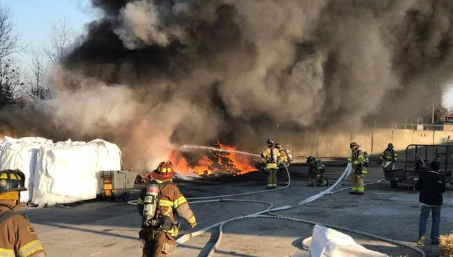 Chambersburg firefighters on Sunday, Dec. 3, extinguish a blaze outside the Edge Rubber factory on Progress Avenue.