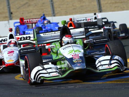 Andretti Autosport driver Carlos Munoz leads a pack