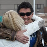 Anthony Cole Padilla hugs Jane Northrup of Authority Staffing outside a Larimer County corrections facility on Thursday, February 4, 2016. Padilla just got his driver's license back so Northrup not longer has to drive him and others to work at odd hours.