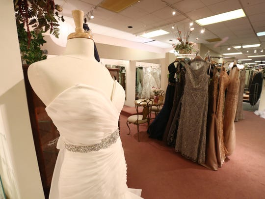 Dresses on display in the showroom at Town Shop in