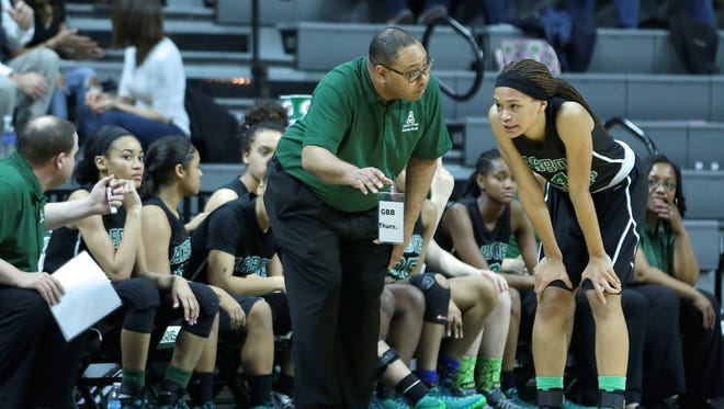 Ypsilanti Arbor Prep's head coach Rod Wells gives instructions to Nastassja Chambers (4) during Ypsilanti Arbor Prep 72-44 win in Girls Basketball Class C Semifinal on Thursday, March 17, 2016, at the Breslin Center in East Lansing, MI.