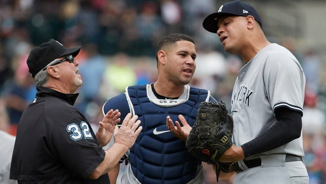 New York Yankees relief pitcher Dellin Betances (68) reacts in front of catcher Gary Sanchez (24) after he is ejected by umpire Dana DeMuth (32) in the seventh inning against the Detroit Tigers at Comerica Park on Thursday, Aug. 24, 2017.