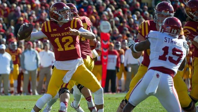 Iowa State Cyclones quarterback Sam Richardson (12) throws against the Oklahoma Sooners at Jack Trice Stadium.