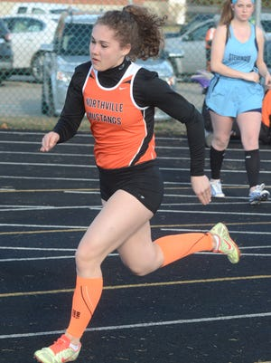 Northville's Lindsay Walters powers out of the blocks in the 400-meter dash heat in Tuesday's win over Stevenson.